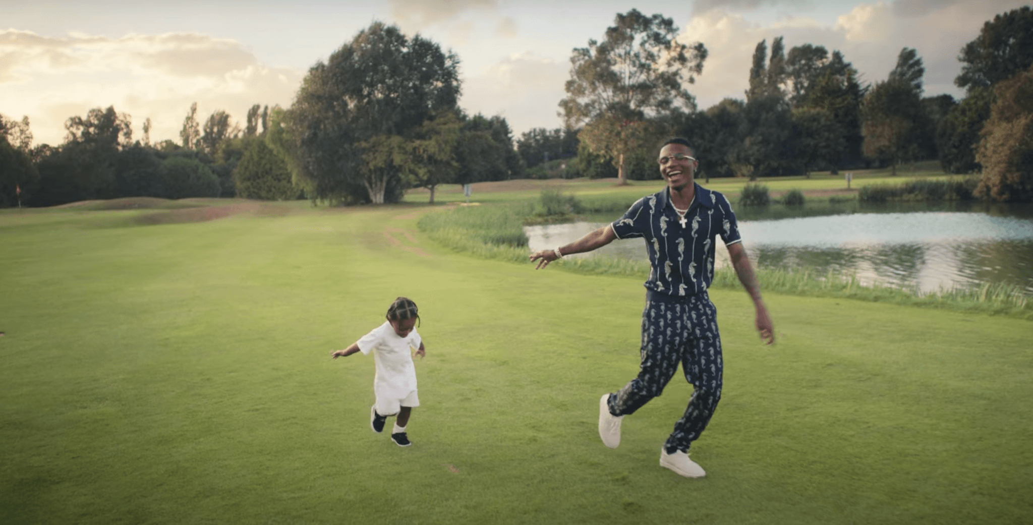 Watch Wizkid in the cheerful video for Smile ft H.E.R